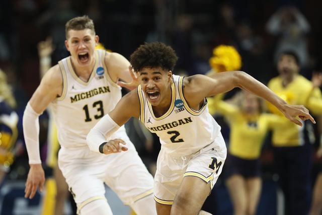 Michigan beats Houston on Poole's buzzer-beater