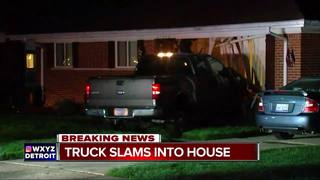 Truck slams into home in Farmington Hills