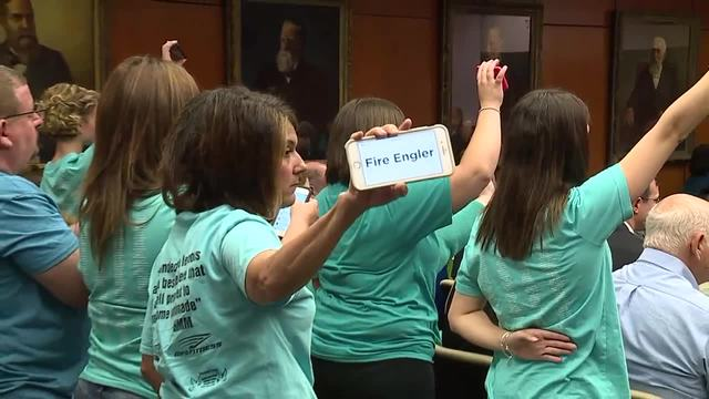 Protestors yell during the MSU Board of Trustees meeting