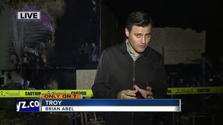 Neighbor saves Troy family from fire