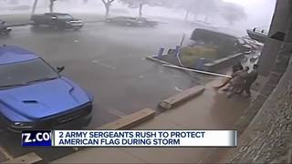 Army Sergeants rush to protect American flag
