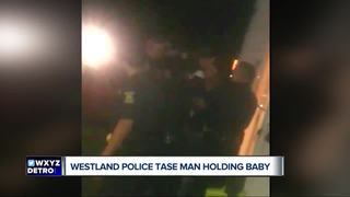 Cops accused of tasing man holding baby