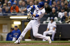 Yelich hits 2 HRs, Brewers draw even with Cubs