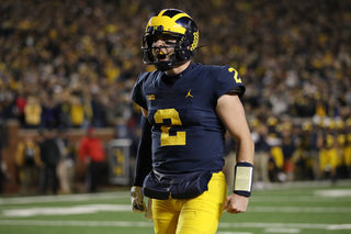 Patterson, No. 12 Michigan rout No. 15 Wisconsin